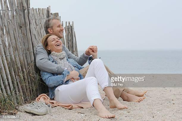 Older couple hugging on beach