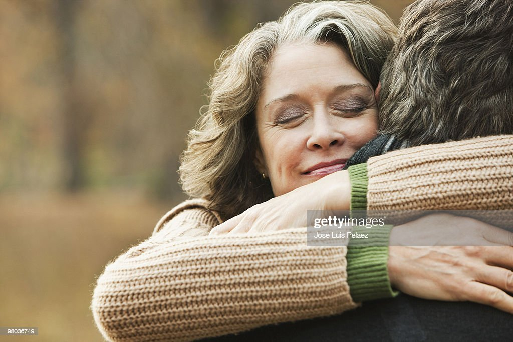 Older couple hugging : Stock Photo