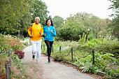 Older couple jogging in park