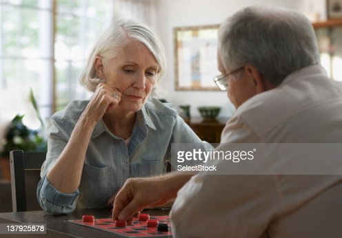 Older couple playing checkers