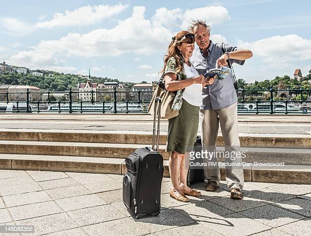 Older couple reading travel guide