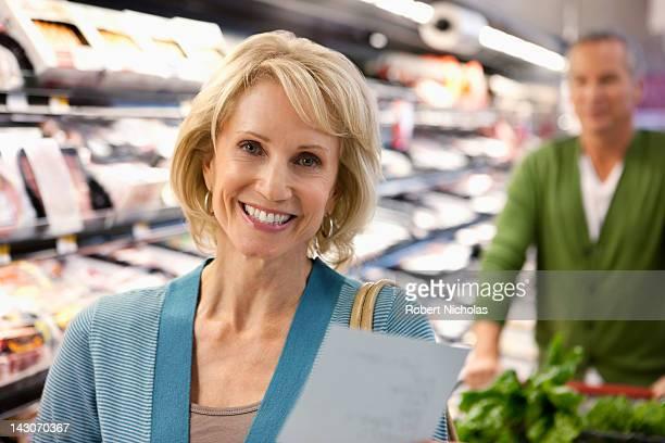 Older couple shopping in supermarket
