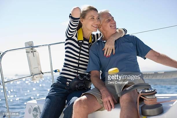 Older couple sitting on boat