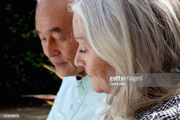Older couple sitting outside together