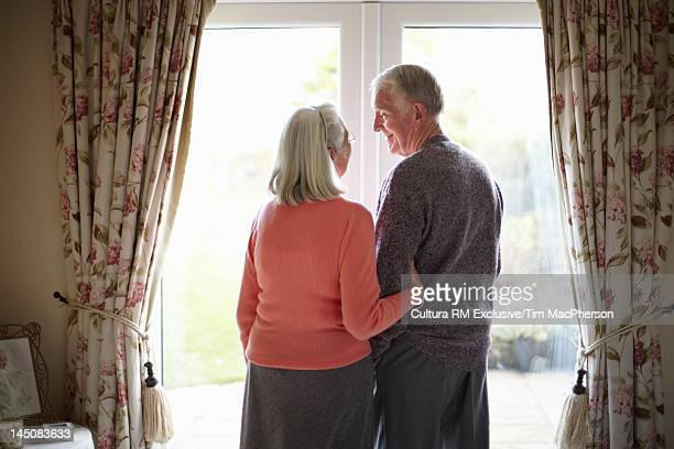 Older couple smiling together in home