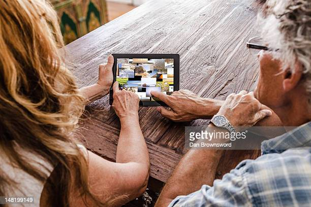 Older couple using tablet computer