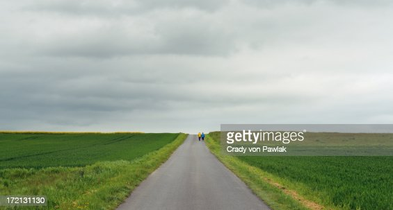 Older couple walking down lonely road