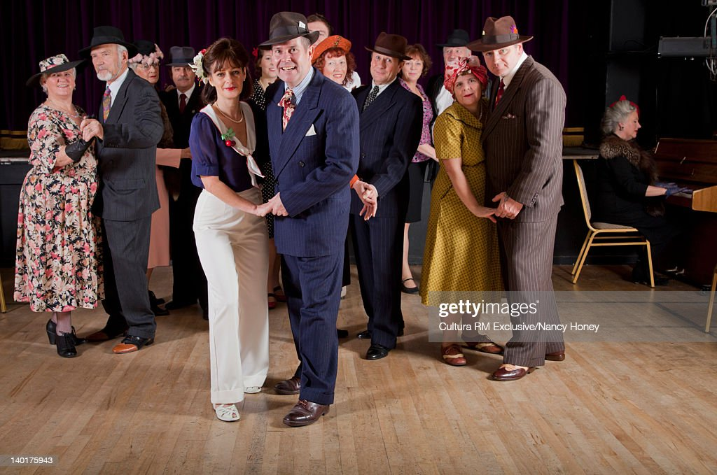Older couples dancing in auditorium : Stock Photo