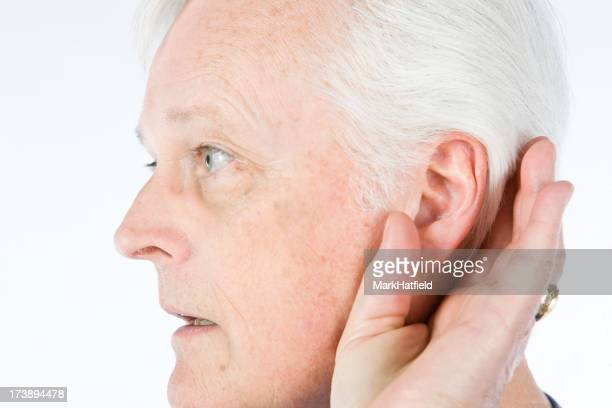 Older Gentlemen Cups His Ear To Hear Better