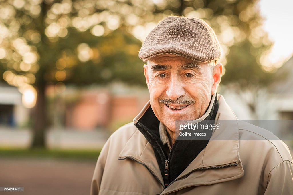 Older Hispanic man smiling outdoors