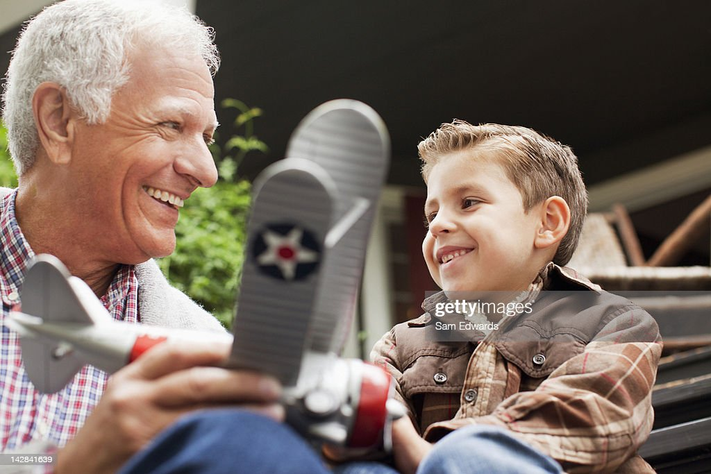 Older man and grandson with model plane : Stock Photo