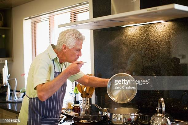 Older man cooking in kitchen
