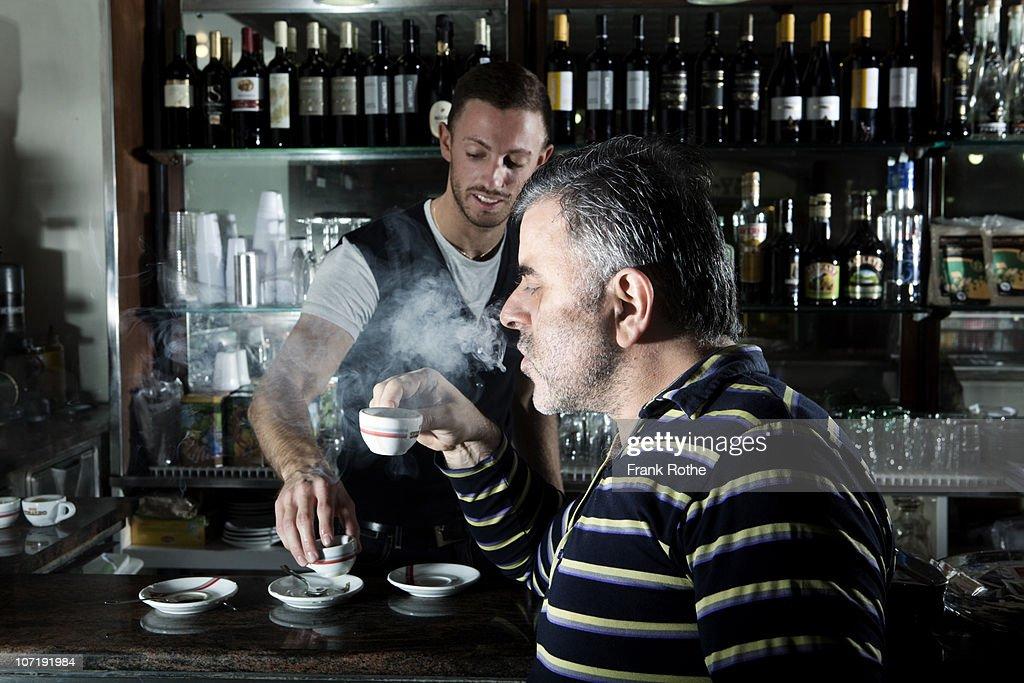 older man enjoys his coffee in a espresso bar  : Stock Photo