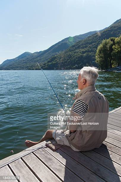 Older man fishing in lake