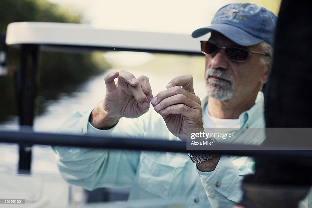 Older man fishing stock photo getty images for Florida fishing license for seniors