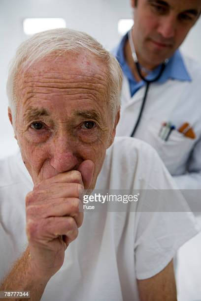 Older Man Getting Examined by Doctor