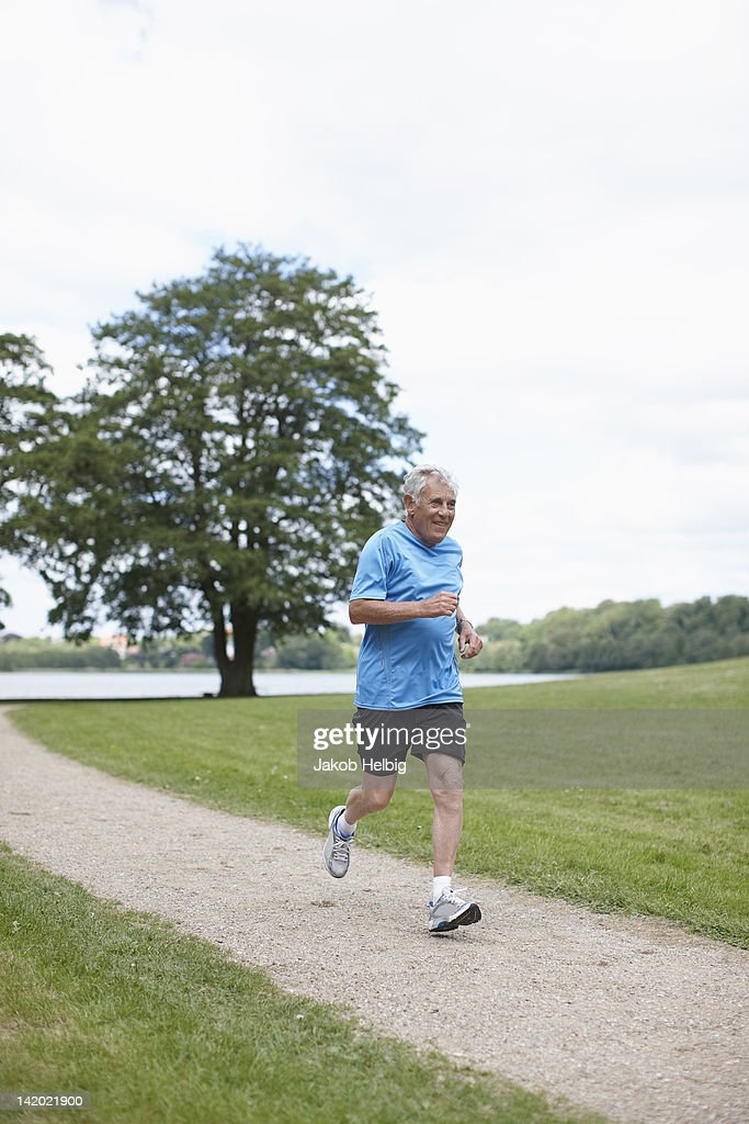 Older man jogging on dirt path