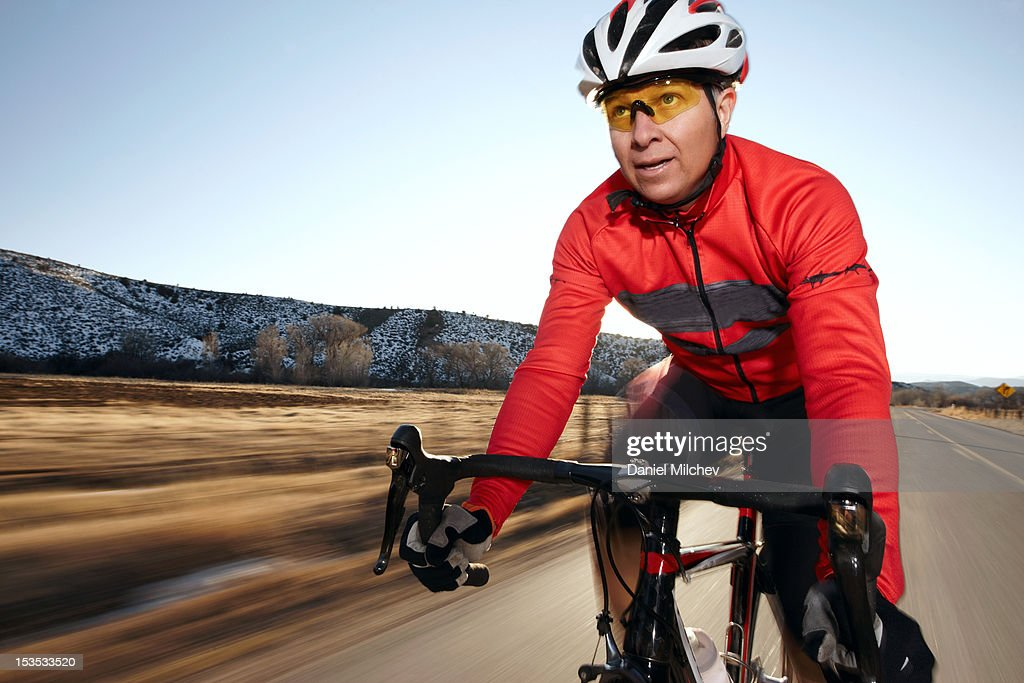 Older man on a rod bike, going fast. : Stock Photo