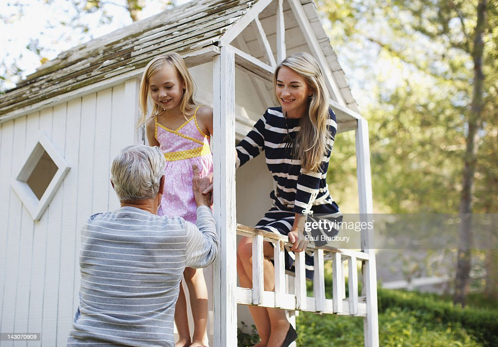 Older man playing with granddaughter : Stock Photo