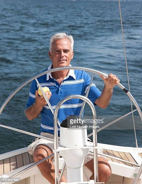 Older man sailing on lake