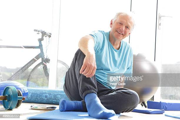 Older man sat in gym room