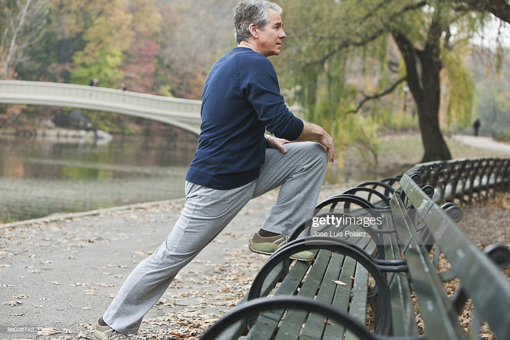 Older man stretching : Stock Photo