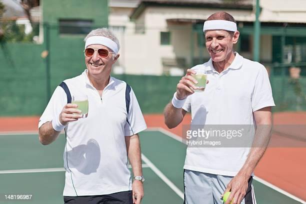 Older men drinking lemonade on court