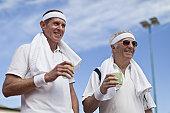 Older men drinking lemonade outdoors