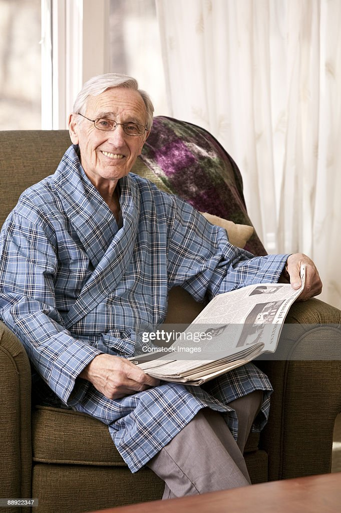 Older Person Relaxing At Home Stock Photo | Getty Images