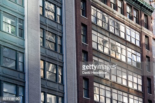 Older style brick buildings in contrasting styles and colors : Stock Photo