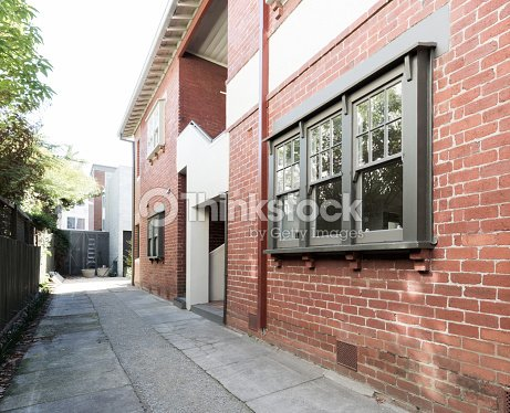 Older Style Red Brick Apartment Building Exterior Stock Photo