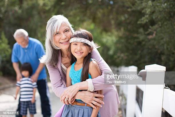 Older woman and granddaughter smiling together