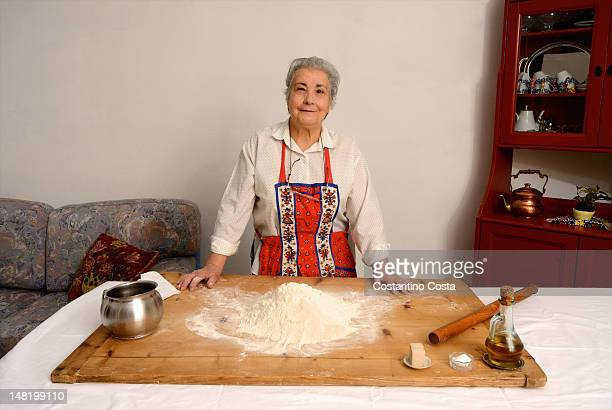 Older woman baking in living room