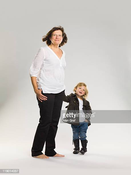 Older woman holding granddaughters hand