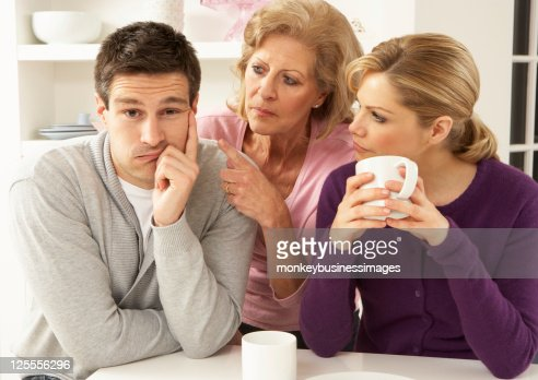 Older woman in between young woman and young man : Stock Photo