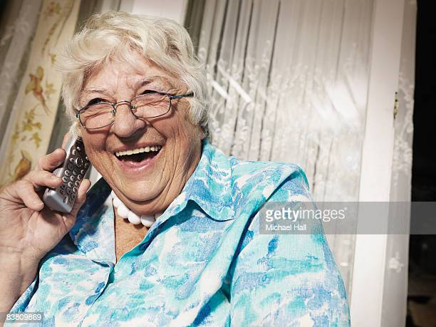 Older woman laughing into the phone