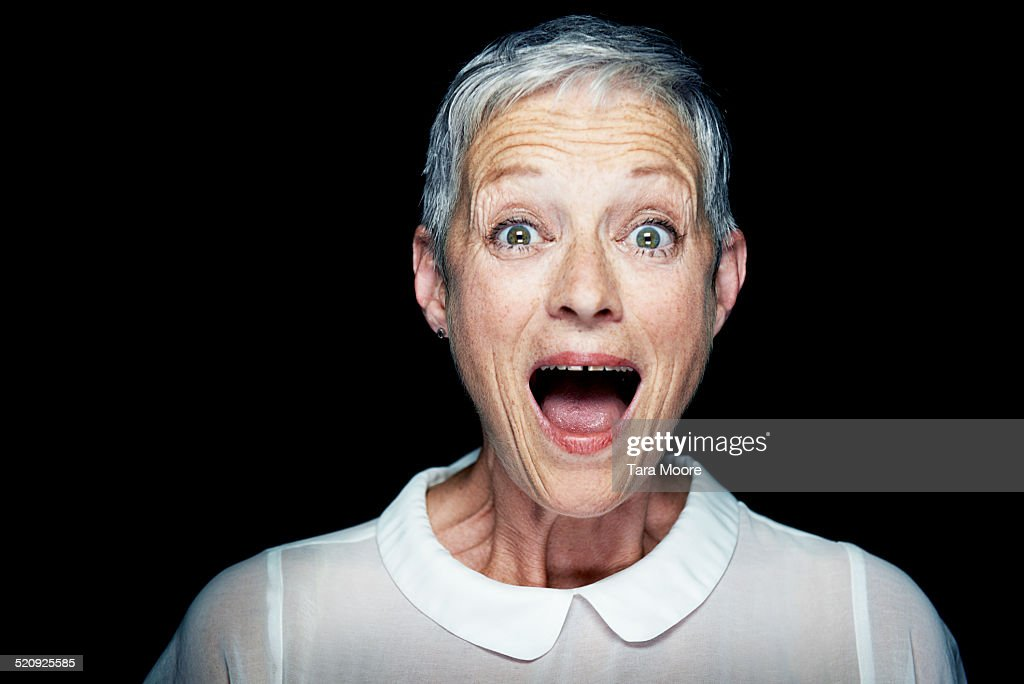 older woman looking surprised