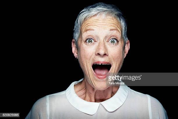 older woman looking surprised