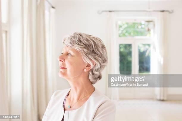 Older woman overlooking living space