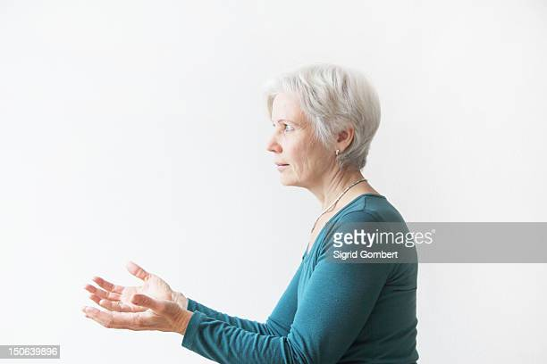 Older woman reaching forward