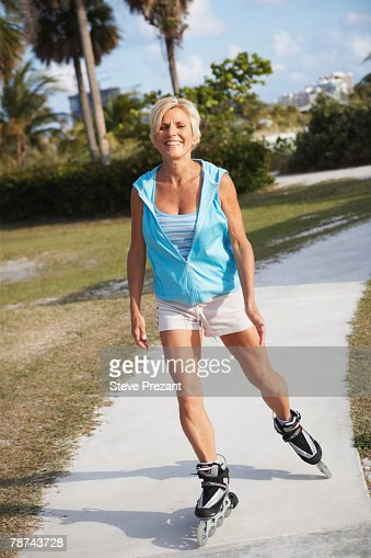 Older Woman Rollerblading Stock Photo | Getty Images
