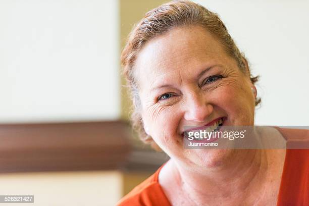 Older woman smiling for the camera.