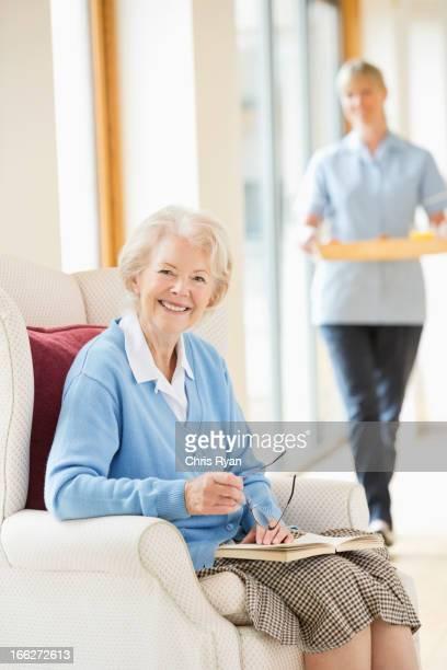 Older woman smiling in armchair