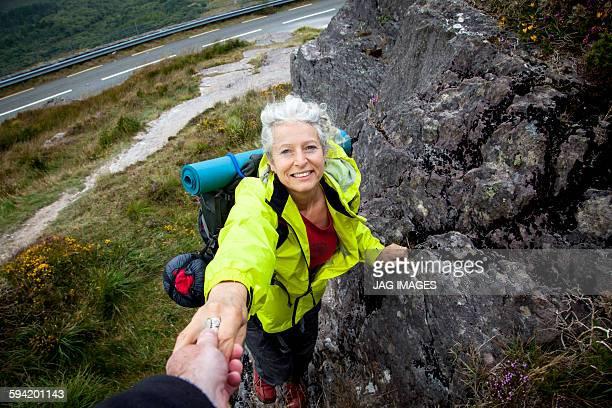 Older woman trekking in the mountains of ireland