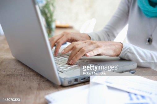 Older woman using laptop : Stock Photo