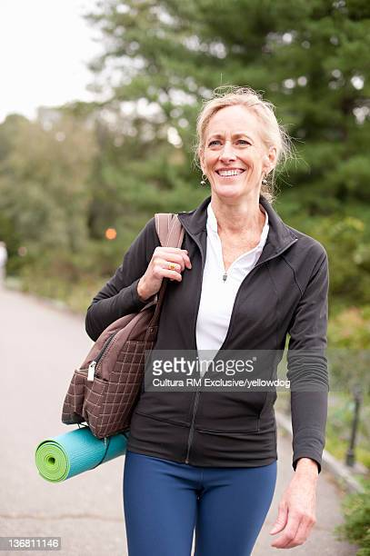 Older woman walking in park