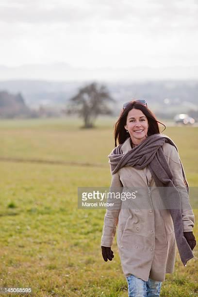 Older woman walking in rural landscape