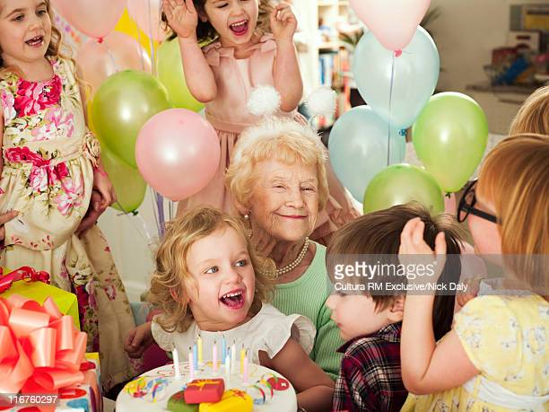 Older woman with children at party