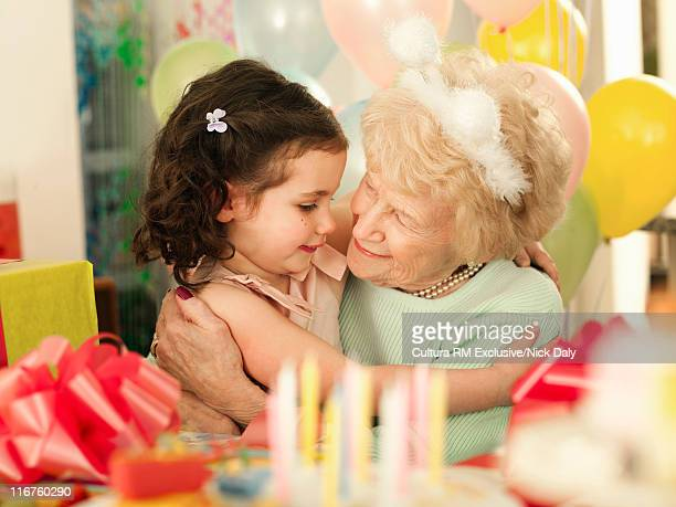 Older woman with granddaughter at party