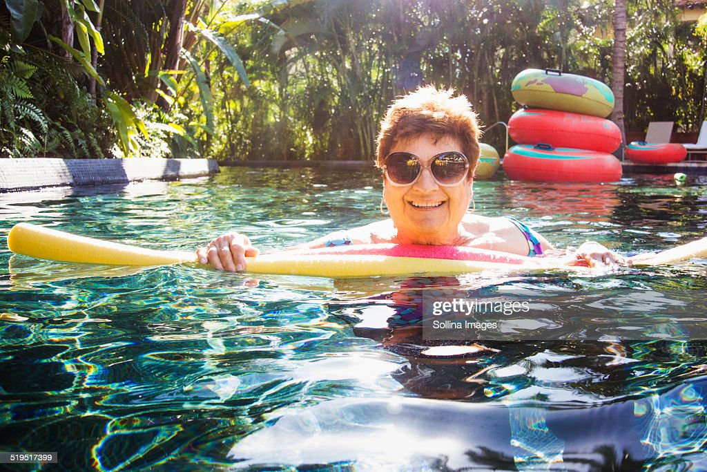 Older woman with sunglasses in swimming pool